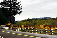 This is a photography of a train going through the columbia river gorge in oregon
