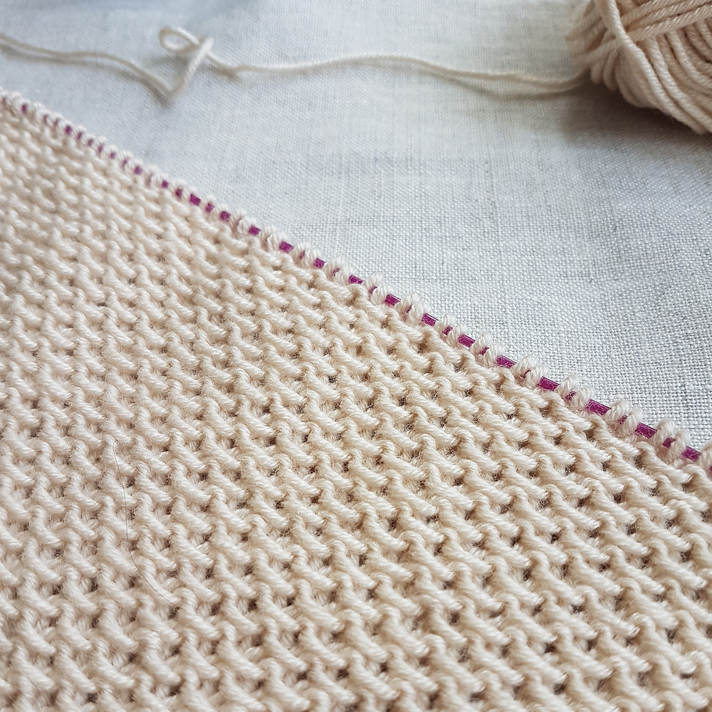 A close up of knitting on the needles