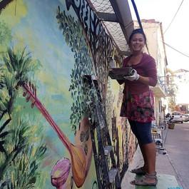 Nasrah Nefer - Gigi Art, working on a wall