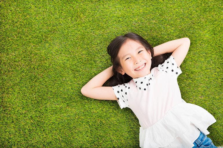 girl lying on grass 1.jpg