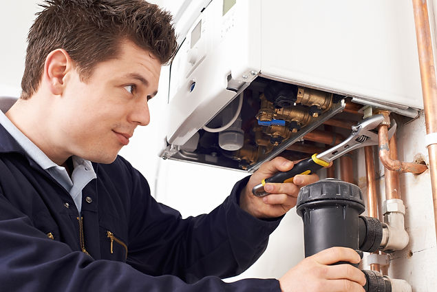Male Plumber Working On Central Heating