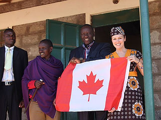 ki.nancy-stevens-holds-a-canadian-flag-w
