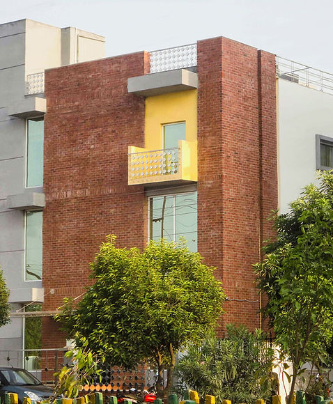 Exposed brick facade of Commercial Building for TPM group in Noida, NCR; Designed by Designsapes, one of the topmost Architecture firm in India