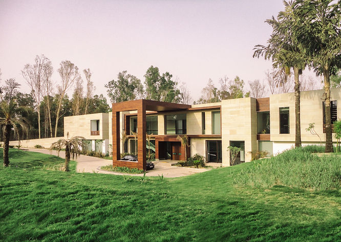Gwalior white stone & IPE facade of the Farmhouse in Kapashera in Delhi; Designscapes is one of the best Architectural, Interior Design and Project Management Consultancy Firms in India