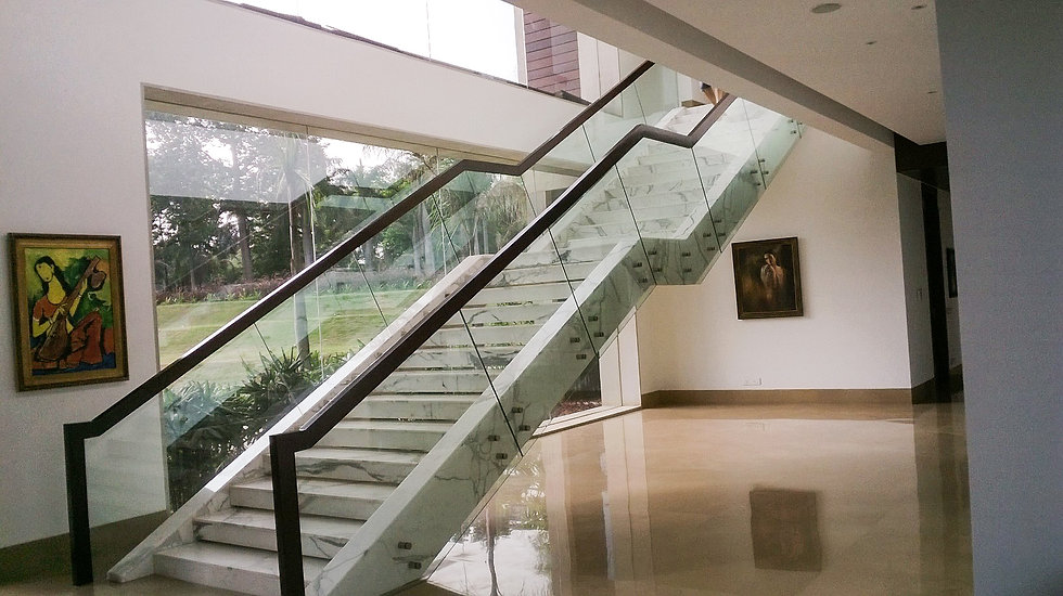 Satvario white marble & glass rail at Farmhouse in Kapashera in Delhi; Designscapes is one of the best Architectural, Interior Design and Project Management Consultancy Firms in India
