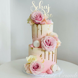 Two tier first birthday cake