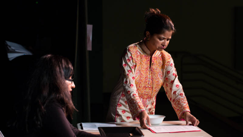 "In ""Just Be Happy,"" Dr. Bibi Das plays a mother struggling to talk to her daughter, played by Preeti Talwai, about depression. (Photo: Jeff Enlow/KQED)"