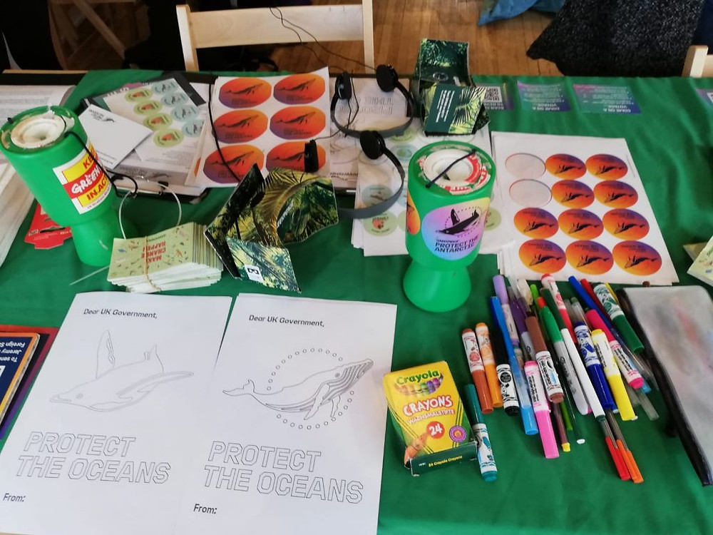 A table with various craft activities surrounding the theme of protecting the oceans.