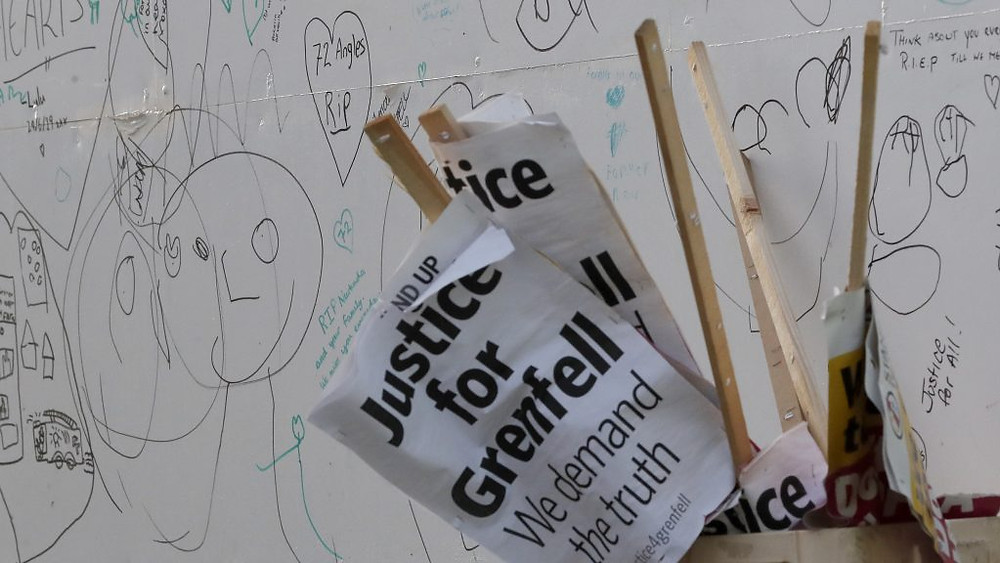signs saying justice for grenfell