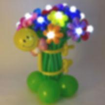Стойка со светящиемися цветами из шаров