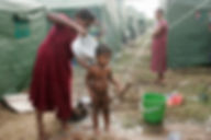 A picture of a woman washing her little boy in a refugee camp in north Sri-Lanka after a Tsunami hit in 2004