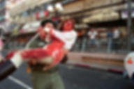 An injured bleeding woman carried by a soldier after bombing in Dizengoff Street