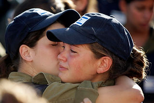 Two women IDF soldiers hug while crying during pullout of Gaza