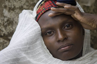A portrait of a Jewish Ethiopian woman of the Falash Mura community in traditional clothing