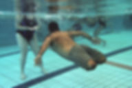 A picture of an injured Druze soldier of the IDF under water in a pool during rehabilitation