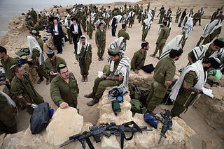 In the picture IDF soldiers of the orthodox battalion during morning prayer on Masada