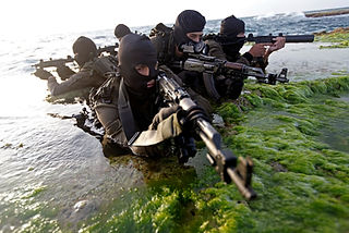 Israeli Flotilla 13 - Special operations unit of the Navy combatnts in training at sea, wearing mask and holdig weapons