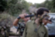 In te photo the commando combat of the IDF instructor Nadav Yair demonstrating an armed threat on a soldier