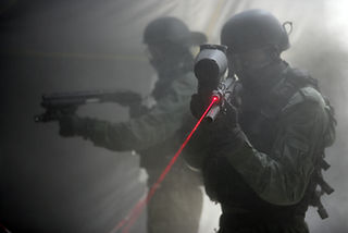 "In the picture two members of Israel Prison Service (IPS) elite unit ""Mesada"" during training in a smoke filled space"