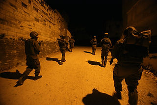 In the picture soldiers of the IDF unit Haruv during night patrol in a Palestinan village