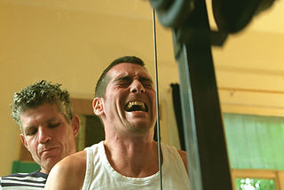 A picture of an HIV carrier man during training at the gym