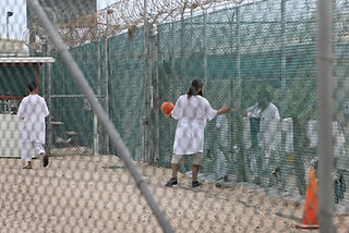 A picture of imprisoned of Guantanamo Bay Detention camp during a ball game