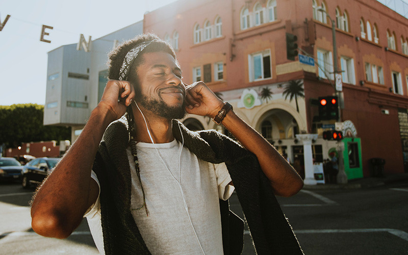 Man wearing earphones, enjoying music