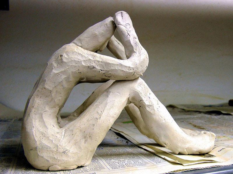 Clay sculpture of sad person