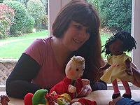 Therapist using play therapy with dolls