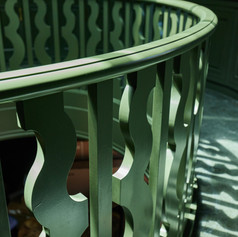 WE DESIGNED THE MEZZANINE BANNISTER OVER A GENTLEMAN'S LIBRARY LOOSELY FOLLOWING A PATTERN WE DISCOVERED IN A BOOK ON SPANISH ARCHITECTURE.