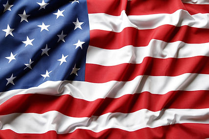 A cropped photo of the American flag. It looks as if it is blowing in th wind