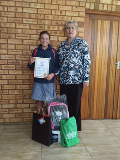 Laerskool Randhart Gr 6 learner Charné Strydom placed third for her Seattle Coffee Company drawing to the delight of principal Marlene Gerber.
