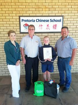 Pretoria Chinese School Art Teacher Ms Anastatia Calitz, Mr John Gelling (principal), Nina Olivier (Gr 5) and Shaun Murphy.