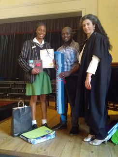 Back page winner Lydia Nsenda-Chrispin of Jeppe High School for Girls and Miss Dina Goncalves (Headmistress).