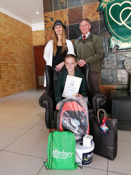 Gr 5 pupil Marise Helberg clinched second spot for her amazing My Bus artwork. With her school Laerskool Concordia principal Mr Lodder and Compassion Art instructor Sheree Pornalis.