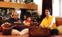 3 Generations together in their Music room