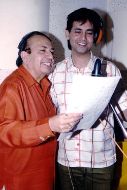 Ruhan recording a song with father