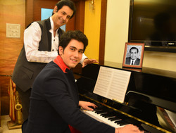 Ruhan listening keenly to Sidhant's new composition