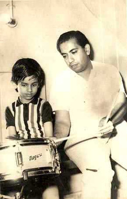 Little Ruhan learning music from father