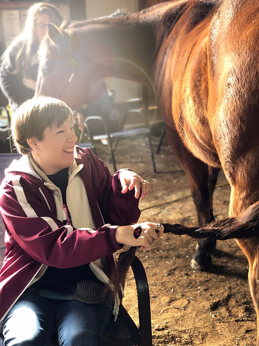 A client recieving equine-therapy.