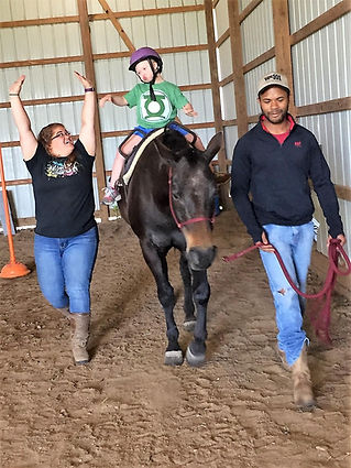 A client in an equine-therapy session.