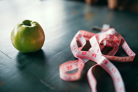 apple-and-pink-measuring-tape-weight-los