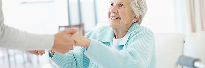 Elderly woman being assited at home