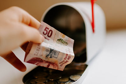 adding-money-to-her-mailbox-bank-D687HVZ