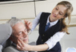Travel Companionship and care provider assisting a patient on plane