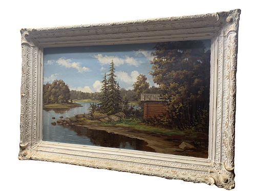 Oil on canvas of a landscape painting in white painted frame 19th. century