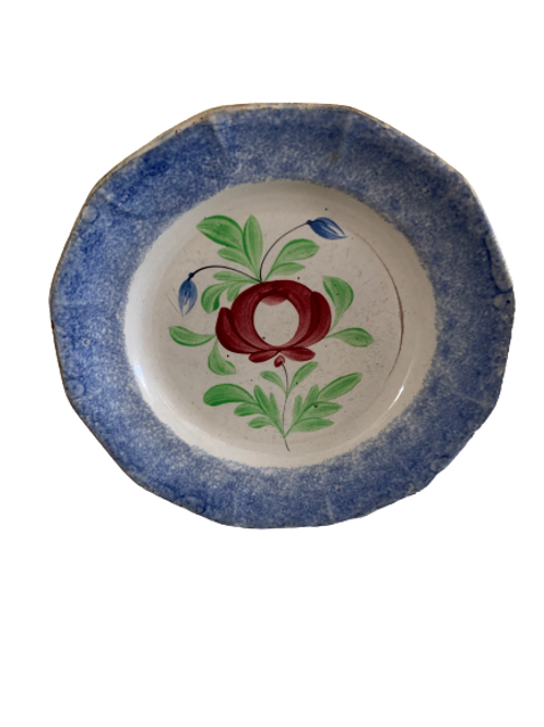 Red white and spatter ware plate