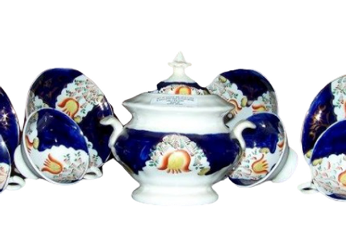 SET OF SIX CUPS AND SAUCERS WITH SUGAR BOWL
