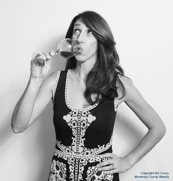 Jannae drinking wine