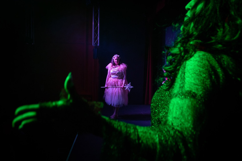 "Photograph from theatre production of ""Jack and the Beanstalk"" showing the Fairy Sugardust over spread shoulder of the bad fairy Picalilli."